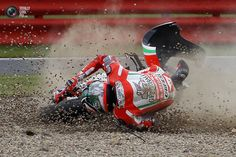 Ducati MotoGP rider Hayden of the U.S. crashes during qualifying for the British motorcycling Grand Prix at the Silverstone circuit. STEFAN WERMUTH/REUTERS