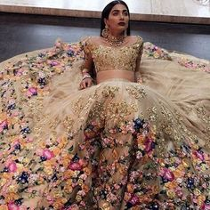 Floral indian wedding dress in gold; a really modern indian wedding dress but it's gorgeous!