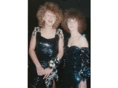 me and @Yvette Moten at the prom 1989 we sure rocked the hair and the dresses!!