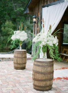 I love Baby's Breath and Pussy Willows on top of Wine Barrels