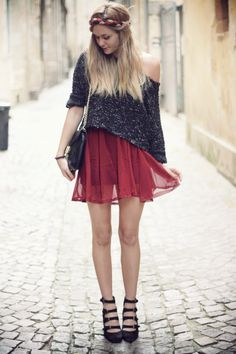 Oversized/off the shoulder sweater, dress/pleated skirt, quad strap heels.