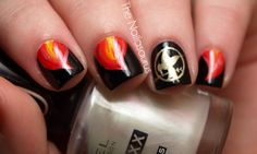 This site is amazing, so many nail ideas! Love the Hunger Games themed nails, this girl is TALENTED!