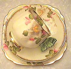 Royal Albert 'Christmas Rose' butterfly handles.  From royalalbertpatterns.com