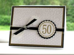 50th Anniversary 2---Drawing on the invitation, then add the cross and 60 on the ribbon around the invitation?