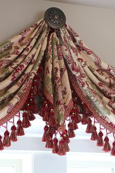 Rosy Queen Swags Over Rosette Valance Curtain Drapes Marie Antoinette style curtain is simply decadent and voluptuous. Palace cream chenille fabric woven with large-scale floral and acanthus patterns in rosy red golden thread. Red and gold tassel fringes Rideaux Shabby Chic, Swags And Tails, Pelmets, Curtain Designs, Curtain Ideas, Drapery Ideas, Curtain Patterns, Arched Windows, Bay Windows