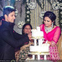 Ravi Dubey and Sargun Mehta cut a cake during their wedding reception, held in Mumbai, on December 13, 2013.