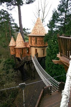 "Definitely don't want this fancy...but I like how the treehouse has a rope bridge to a smaller ""deck."""