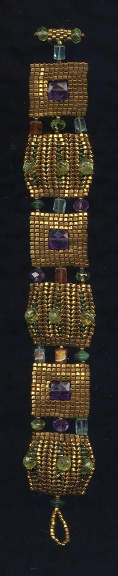 Klimt Bracelet by Jeka Lambert.   Seed bead woven.  24K gold plated seed beads, amethyst, peridot, hessonite garnet, adventurine, apatite, cubic zirconia. by rosemary