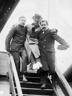 Here Titanic's junior wireless officer Harold Bride is helped off the RMS Carpathia. His Feet are heavily bandaged after he suffered frostbite.
