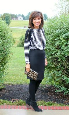 Styling a pencil skirt for fall with leggings and black booties.