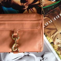 "studded leather crossbody NWT. Peachy color. Studded bottom and strap which is part chain. Zip top closure. Open pocket inside. Front outside pocket features a zipper. Zippers have leather tassels (extras included). Gold tone hardware. Measures approx. 9"" x 6 1/2"" x 1 3/4"". Price firm. ❌No Trades 
