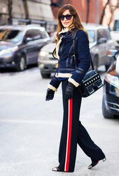Accessorize the sporty slacks with cap-toe boots like Ece Sükan