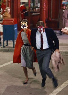 """Breakfast at Tiffany's"" (1961). The end of the shoplifting sequence. Audrey Hepburn and George Peppard shown, masked."