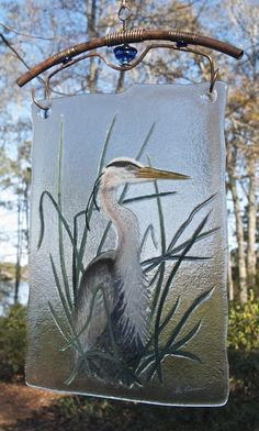 This is fabulous fused glass art.  Stan Harmon Glass Art. Love the glass and how it is hung!