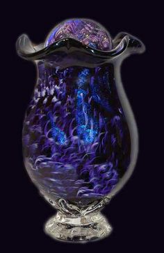 This is actually a cremation urn with a glass ball lid. Incredibly beautiful.