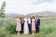 An epic Lake Tekapo wedding, surrounded by mountain views and lupins at the height of spring. Married in the Church of the Good Shepherd. So many colourful summer blooms created the backdrop for so many bridal portraits! Lake Tekapo, Anna, The Good Shepherd, Bridal Portraits, Summer Wedding, In The Heights, Backdrops, Bloom, Mountain
