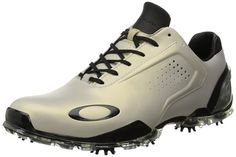 Made from leather with a manmade sole these mens carbon pro golf shoes by Oakley feature a carbon fiber shank and dynamic motion control system