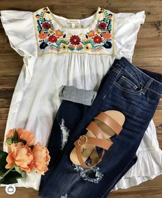 I love this cutie top, white with pop of color, the limited distressing jeans, and the cute simple sandals