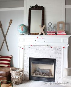 Cute Valentine's mantel with  X and O with ampersand and easy tutorial for heart garland