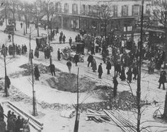 A crater in a Paris street left by a bomb dropped from a German Zeppelin, 1915.