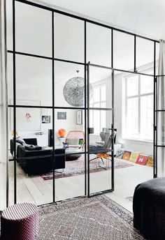 Glass room dividers / elle decoration UK -- This room divider creates definition without obstructing views and light - an important consideration if you have a small, dimly lit space. Home Living Room, Living Spaces, Small Living, Door Design, House Design, Glass Wall Design, Glass Room Divider, Room Dividers, Elle Decor