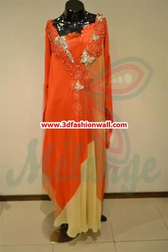 This Pakistani suit is available for 36000 Rs only. The dress has a contrast of orange and yellow. There are several cuts in this suit that is making it unique from the rest of the collection. Overall the dress has an elegant look that will make you in love with this dress.