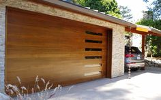 Classy Modern Garage Doors For Your House: Stone Wall Design With Wooden Modern Garage Doors For Modern Exterior Decoration Viewing Gallery Garage Door Colors, Garage Door Windows, Carriage Garage Doors, Wood Garage Doors, Garage Door Design, Timber Garage, Garage Walls, Contemporary Garage Doors, Modern Garage Doors