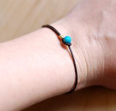 Simple leather wrap bracelet with teal bead by nutmegan on Etsy / recycled ecofriendly #jewelry