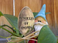 PATROLLED BY GNOMES silver garden marker spoon - hand stamped rustic garden decor - funny gnome quote - planter bed art - gift for gardeners
