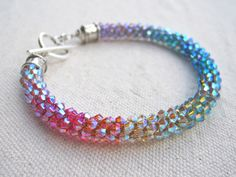 18 colors of 3mm Swarovski crystals to blend and flow into a crystal rainbow