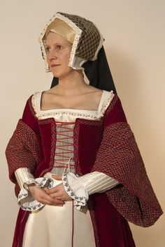The link takes you to an excellent series of photos of a costume modeled after a portrait of Jane Seymour. This photo shows the gown's front lacing; other photos show the stomacher which is pinned over and covers the lacing.