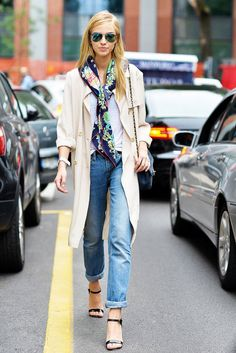how to style a scarf - loosely tied silk, printed scarf worn with white tshirt, trench coat + cuffed boyfriend jeans and heels