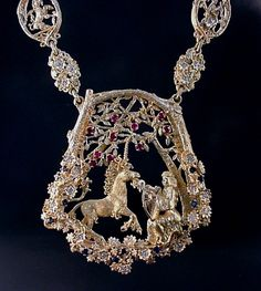 What happens when a maiden meets a unicorn in the woods? In this breathtaking necklace and pendant by Postgate Fine Jewelers, he dances as the maiden plays her harp. This fairy tale duo is captured in 18k gold with trees and flowers exquisitely decorated with diamonds, rubies, and sapphires. Scenes of unicorns, maidens, and flowers appear in the links of the necklace, too.