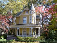 Victorian Home. Beautiful yellow Victorian home with white gingerbread work White Trim, Future House, My House, Ideal House, Victorian Style Homes, Folk Victorian, Porch And Balcony, Yellow Houses, Victorian Architecture
