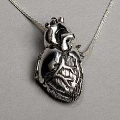 Anatomical heart locket. My anatomy and physiology teacher would love this!! Lol
