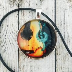 Stunning Guitar pendant.  Many more musical pendants and key rings in our store.  @theflaming_galah #handmadesydney #handmadejewelry #etsygifts #etsygiftideas #etsygiftsau #etsygiftsforhim #etsygiftsformen #guitar #guitarist #guitargift #giftshop #giftforguitarist #guitarplayer #guitargift #etsyau #secretsanta #stockingfillers #giftformusician #muso #christmasideas #theflaming_galah #guitarkeyring #guitarkeychain #guitarnecklace #supporthandmade #coolgifts #unusualgifts