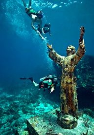 Christ of the Abyss is a 8 1/2 foot, 4000 pound bronze sculpture of Jesus Christ that stands in 25 feet of water off of Key Largo, Florida. It is located near Dry Rocks, about six miles east-northeast of the Key Largo Cut, in the John Pennekamp Coral Reef State Park. Christ of the Abyss is one of the most famous and popular underwater sites in the only underwater park in the world.