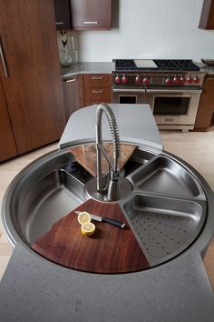 OMG - so useful! rotating 'lazy suzan' type station that includes cutting and draining boards along with various basins with a centered, stationary faucet - fabulous and functional, especially for an island or small kitchen space.