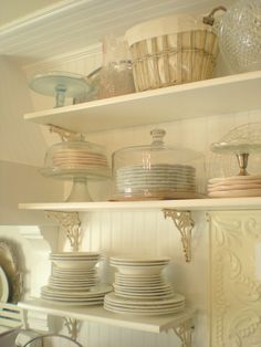 love the idea of using cake domes to keep rarely used plates clean on open shelving
