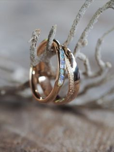 At @gardensofthesun, they don't just create jewelry. They shake things up, gently. To turn destructive practices into positive impact - the kind that changes lives. Every decision made is infused with love & care for our planet. #EngagementRing #WeddingRing #Engagement #Proposal #EngagementIdeas #ProposalIdeas #Engaged #Wedding #WeddingIdeas #WeddingPlanning #WeddingPlanner Bridal Accessories, Bridal Jewelry, Rustic Wedding Bands, Gold And Silver Rings, Rough Opal, Hand Engraving, Opal Rings, Or Rose, Gardens