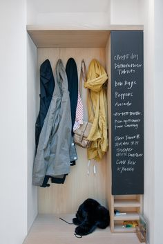organized entry--I like the chalkboard for messages and reminders.  I'd shorten it, tho, and add a bin or cubby for each person, plus a shoe rack at the bottom...