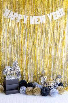 New Years Eve party photo booth. With affordable photo booth props in black, gold, and silver.