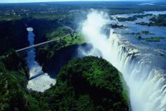 Victoria Falls, a waterfall up the Zambezi River on the border of Zambia and Zimbabwe. Are located in the district of Livingstone in the Southern Province of Zambia and the Hwange district, in the region of Mashonaland West, Zimbabwe. Above them is the Victoria Falls Bridge, an old steel arch completed in 1905. They measure approximately 1.7 km wide and 108 m high.