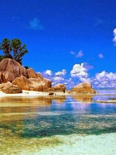 Seychelles. I love this, but getting the colors in the water right would be extremely challenging!