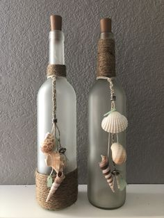 Beach Wine Bottle/ seashells/ burlap/ frosted bottle/ beads/ cork lights/ sea glass/ diy Best Picture For school Craft Wine Bottle Corks, Glass Bottle Crafts, Diy Bottle, Diy With Glass Bottles, Wine Bottle Fence, Alcohol Bottle Crafts, Garrafa Diy, Painted Wine Bottles, Decorative Wine Bottles