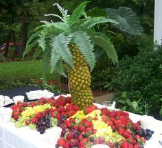 Palm tree made with pineapples. by katy