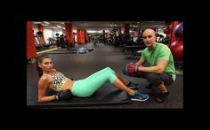 Personal trainer John Benton goes to the mat with model Zandria Theis.