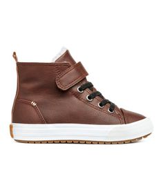 Brown. High tops in faux leather with reinforced toes. Elasticized lacing at front, hook-loop tab at top, and loop at back. Pile lining, pile insoles, and