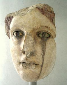 Marble head of a goddess, perhaps Aphrodite (Venus). It is considered to be a copy of a chryselephantine (gold and ivory) statue of the classical era (5th-4th C. BC). The black colour under the eyes owes to the oxidation of the bronze eyelids, now lost.  From Athens, 2nd C. AD  Until recently in the fabulous Roman Collection of the National Archaeological Museum, from which it was detached.  Athens, Acropolis Museum