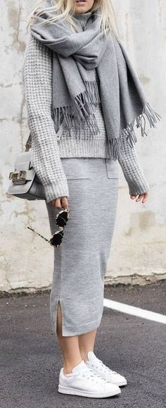 Combining various shades of grey is always a good idea. Figtny wears a slitted grey midi skirt with a cute grey knitted sweater and a matching scarf. Both ideal for the winter cold and effortlessly stylish, this look is a winner! Brands Not Specified.